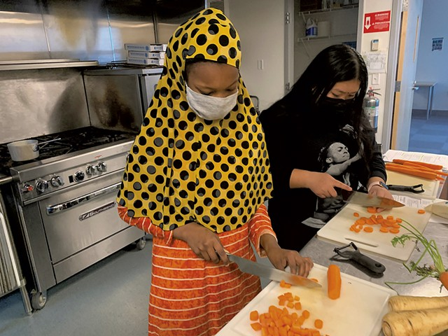 Hawa Aden (left) and Astha Magar chopping vegetables at the King Street Center - COURTESY OF DEENA MURPHY
