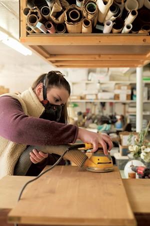 Grace Elletson at work in her studio in Shelburne - BEAR CEARI