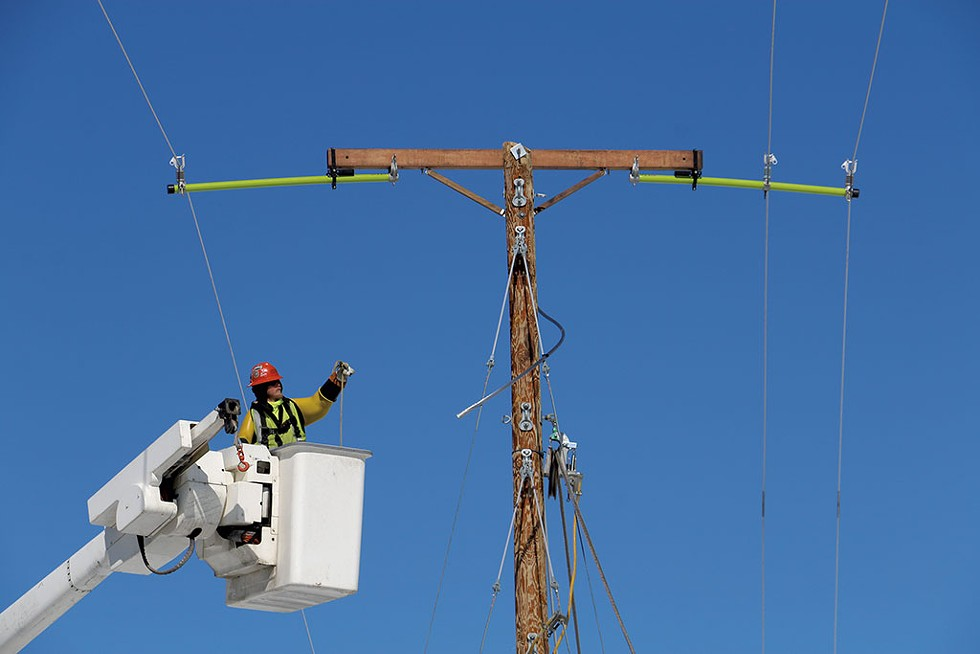 Lineman Cody Crowe upgrading a Green Mountain Power line in Eden - KEVIN MCCALLUM ©️ SEVEN DAYS