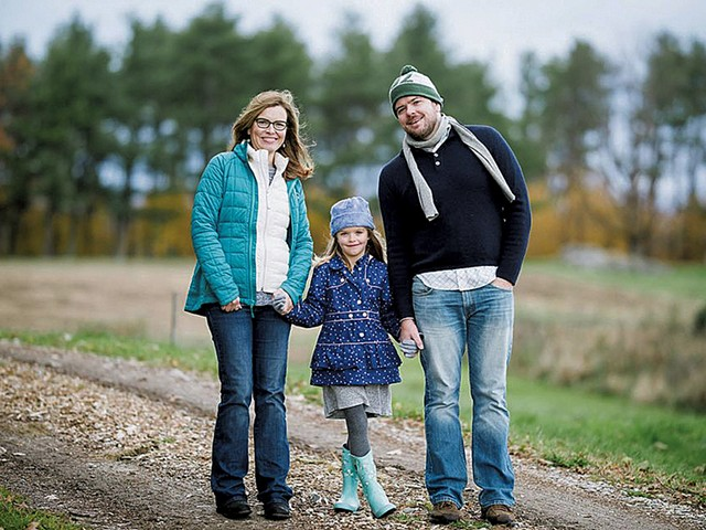 Erica Houskeeper with her husband, Dave Barron, and their daughter Phoebe - COURTESY OF ANDY DUBACK