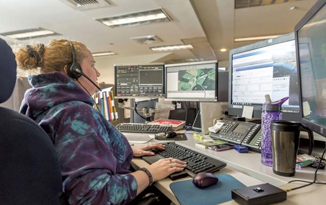 A state emergency dispatcher in Williston - SEVEN DAYS FILE PHOTO