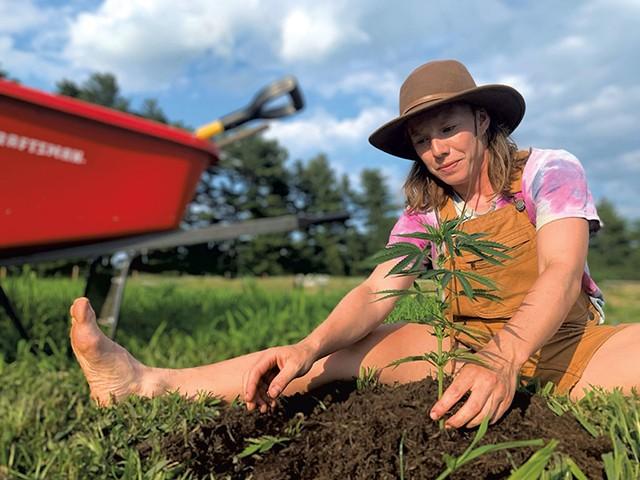 Jahala Dudley with a hemp plant - COURTESY OF KIERSTIN WALL