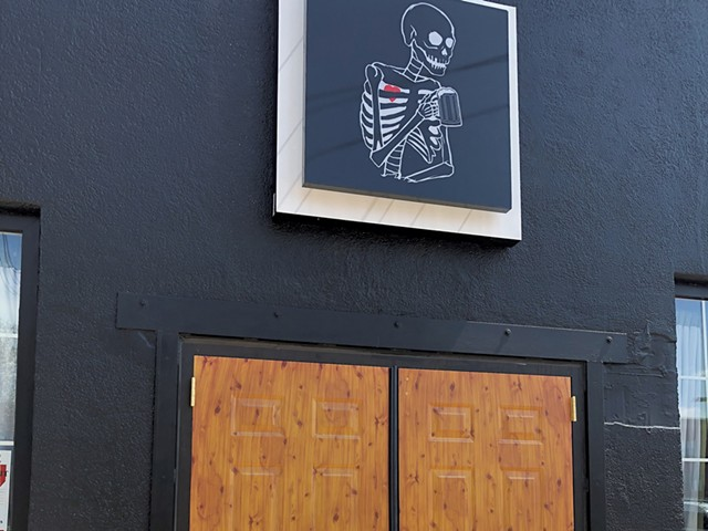 The skeleton sign above the door at Good Trouble - JORDAN BARRY ©️ SEVEN DAYS