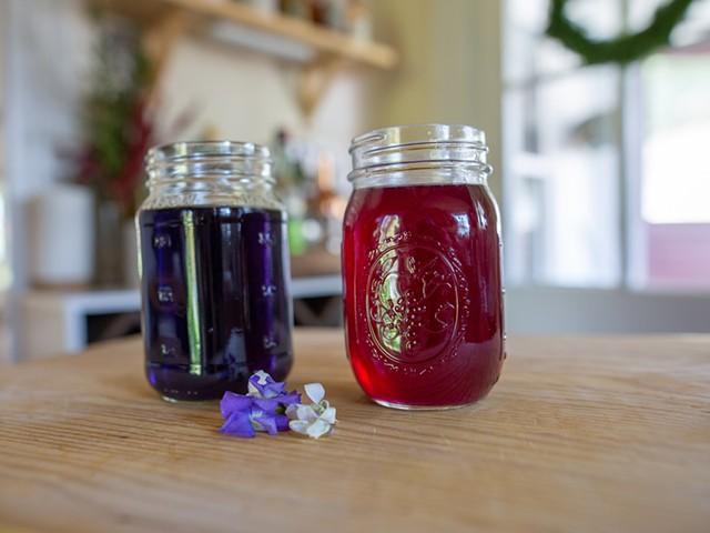 Violet syrup (left) and violet syrup with lemon juice added - JORDAN BARRY ©️ SEVEN DAYS