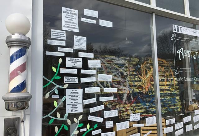 The window of ART, etc. and the Northfield Barber Shop pole - PAMELA POLSTON ©️ SEVEN DAYS