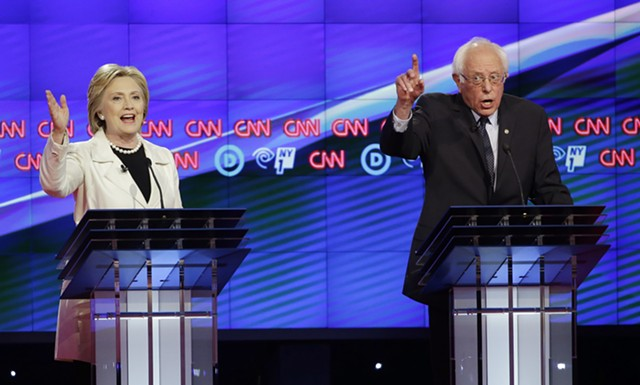 Hillary Clinton and Bernie Sanders debating Thursday night in Brooklyn. - AP PHOTO/SETH WENIG