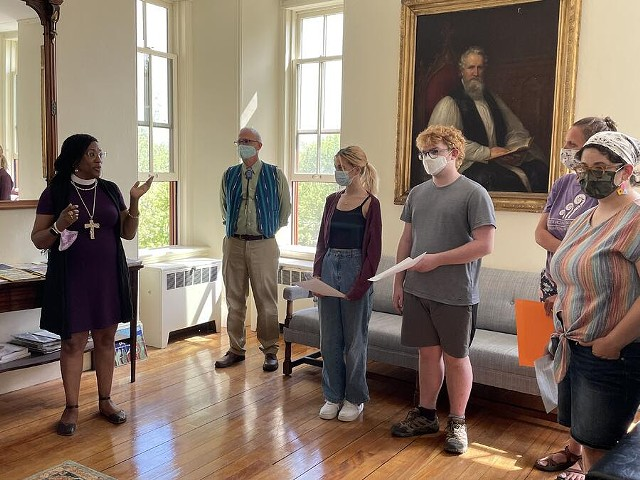 Bishop Shannon MacVean-Brown speaking with students in front of the portrait of John Henry Hopkins that has been removed - COURTESY OF ROCK POINT SCHOOL