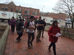Members of Migrant Justice walk towards Sen. Patrick Leahy's Burlington office. - ALICIA FREESE