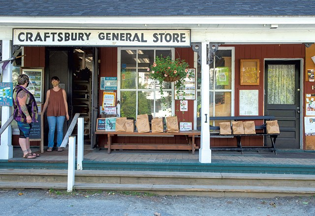 Customers awaiting porch pickup at Craftsbury General Store - FILE: JEB WALLACE-BRODEUR