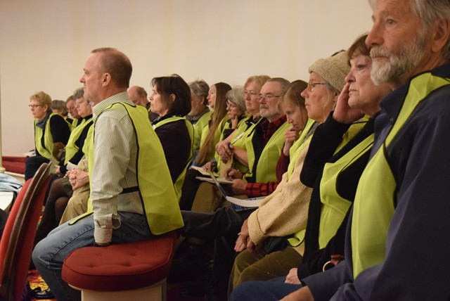 Opponents of wind projects line the House chamber Tuesday wearing neon green vests. - TERRI HALLENBECK