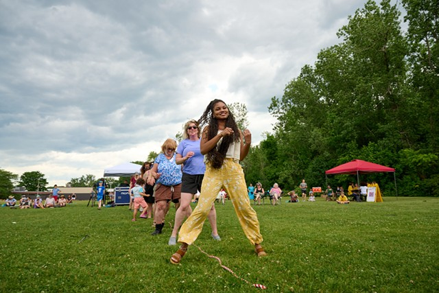 Members of the Judie Emanual Family Band lead the crowd in a dance - BEAR CIERI