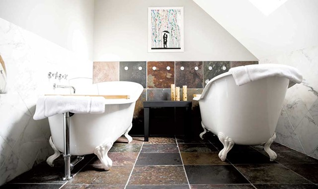 Bathroom with double clawfoot tubs - COURTESY OF THE WOODSTOCKER B&B