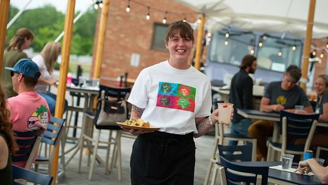 Jennah Berman carrying an order of lake-perch tacos and a spicy margarita - DARIA BISHOP