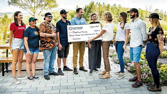 Karen Lawson presenting a check to Downstreet Housing in 2019 - COURTESY