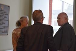House Judiciary Committee chair Maxine Grad (D-Moretown), vice chair Willem Jewett (D-Ripton), center, and Senate Judiciary Committee chair Dick Sears (D-Bennington) talk in a Statehouse hallway Tuesday. - TERRI HALLENBECK