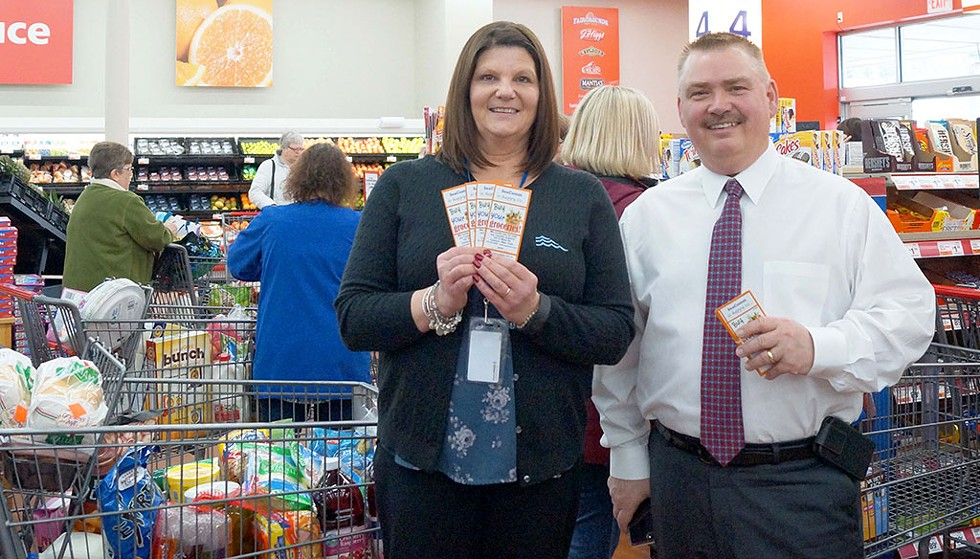 SeaComm buys groceries for 100 local residents (Branch Manager Barbara Bessette and Scott A. Wilson President and CEO) - COURTESY IMAGE