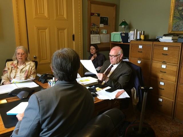 Sen. Dick Sears (D-Bennington) and Sen. Peg Flory (R-Rutland) negotiate with Rep. Chip Conquest (D-Newbury), with his back to the camera, on driver's license-suspension legislation. - NANCY REMSEN