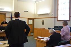 Brooks McArthur, attorney for Sen. Norm McAllister, (left) Franklin County State's Attorney Jim Hughes and Diane Wheeler, deputy state's attorney, listen to Superior Court Judge Robert Mello in court in St. Albans on Friday. - TERRI HALLENBECK