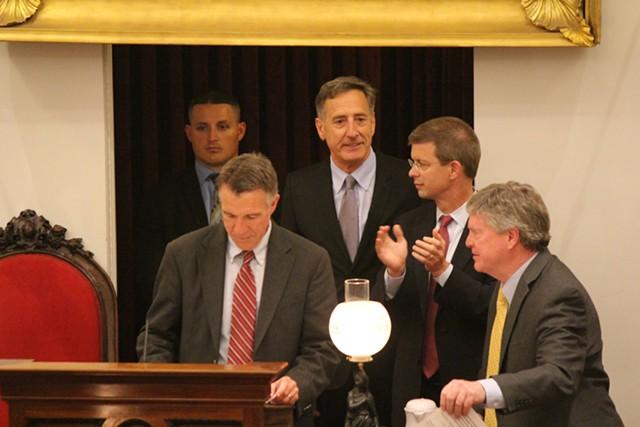 Lt. Gov. Phil Scott, Gov. Peter Shumlin, House Speaker Shap Smith and Senate President Pro Tem John Campbell early Saturday morning as the legislature adjourned