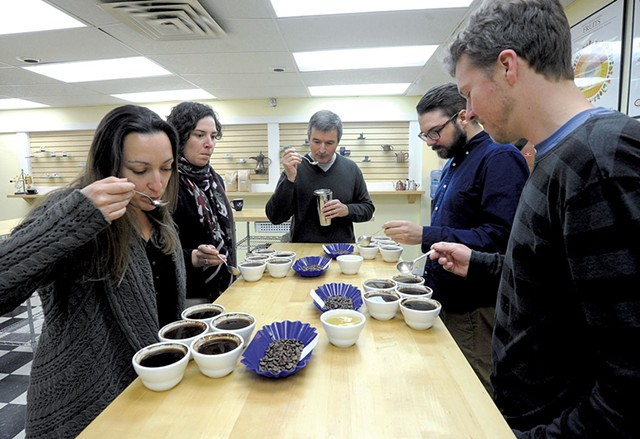 Coffee Lab International staff Shannon Cheney, Debby Pakbaz, Mané Alves, Maxwell Duquette and Josh Parker cupping coffee - JEB WALLACE-BRODEUR