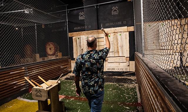 Rick Chaput tossing an axe at Burly Axe Throwing - LUKE AWTRY