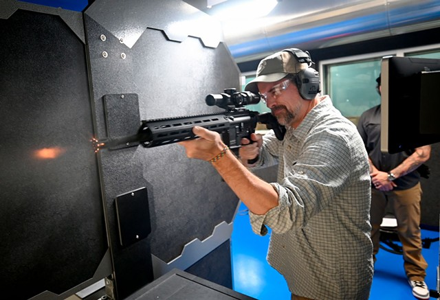 Kevin McCallum firing a Heckler & Koch rifle - JEB WALLACE-BRODEUR