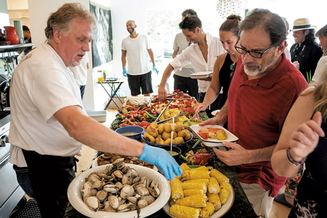 Scott Taylor (left) serving guests - ZACHARY P. STEPHENS