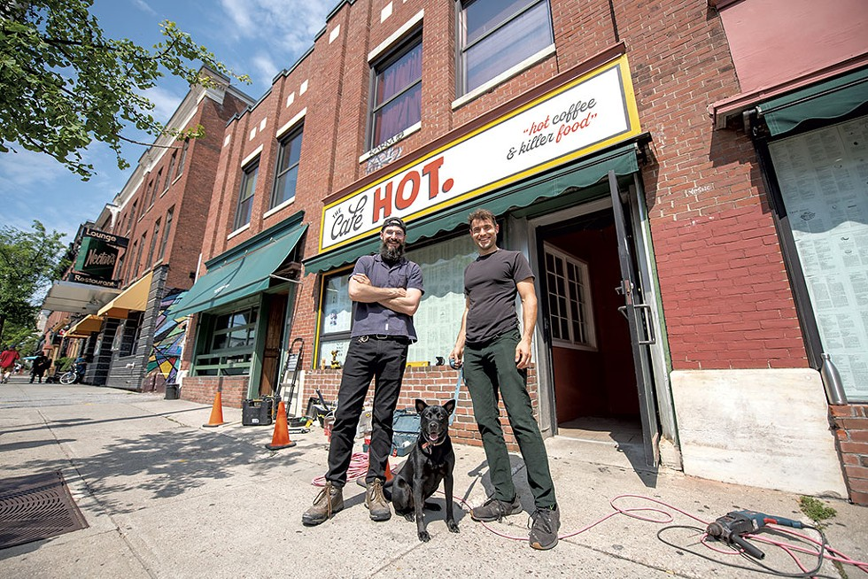 Travis (left) and Allan Walker-Hodkin with BMO the dog outside the Café HOT. - DARIA BISHOP