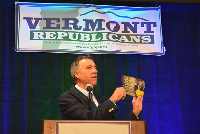 Lt. Gov. Phil Scott holds a flier that rival Republican gubernatorial candidate Bruce Lisman sent out. - TERRI HALLENBECK