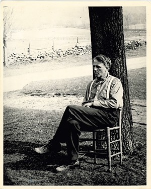 Robert Frost in front of the Stone House in 1921 - PHOTO BY PAUL WAITT   COURTESY OF DARTMOUTH COLLEGE LIBRARY SPECIAL COLLECTIONS