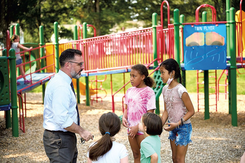 Tom Flanagan with students on the playground at C.P. Smith Elementary School - BEAR CIERI