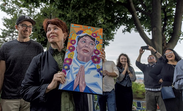 Pamela Polston with a portrait of her painted by Vermont artist Jesse Azarian - JAMES BUCK