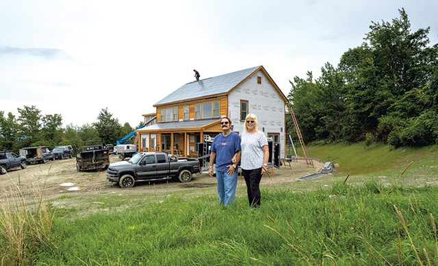 Phil and Debbie Gianelli in front of their Hinesburg home build - JAMES BUCK