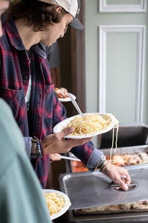 Students serving themselves dinner - LUKE AWTRY