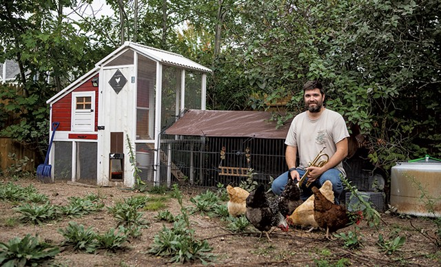Will Andrews in his backyard chicken coop - LUKE AWTRY