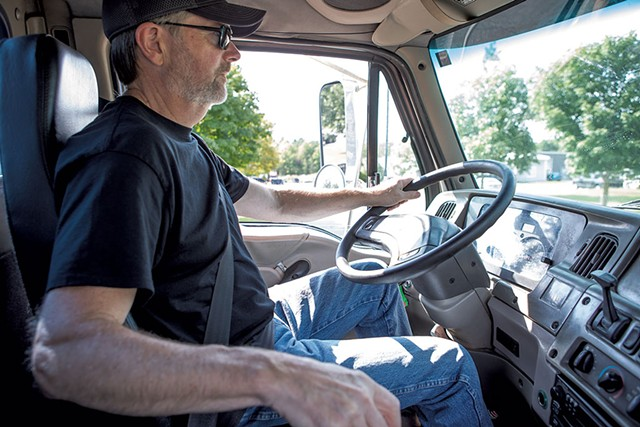 Instructor Mike Brault test-driving the Sterling, a training truck - LUKE AWTRY