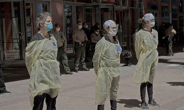 VIRAL DOUBTS Health care workers face anti-lockdown protesters in Wang's documentary about the pandemic in China and the U.S. - COURTESY OF WARNER MEDIA