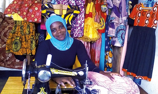 Sarah in Uganda with a sewing machine shipped from Vermont - COURTESY OF PEDALS FOR PROGRESS