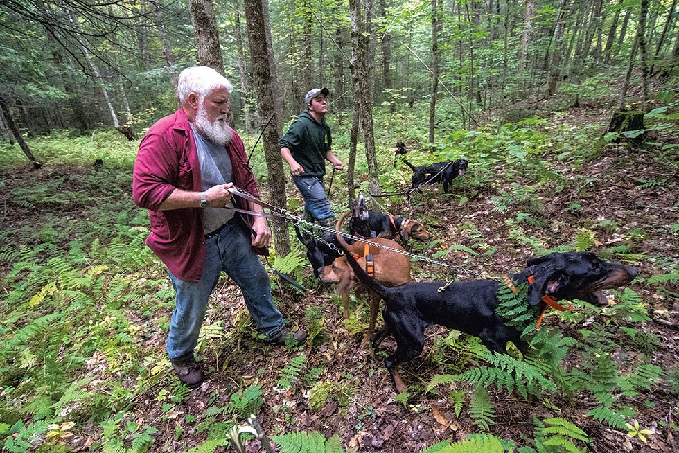 Butch Spear (left) and Michael Jolley collecting bear hounds after a hunt - JEB WALLACE-BRODEUR