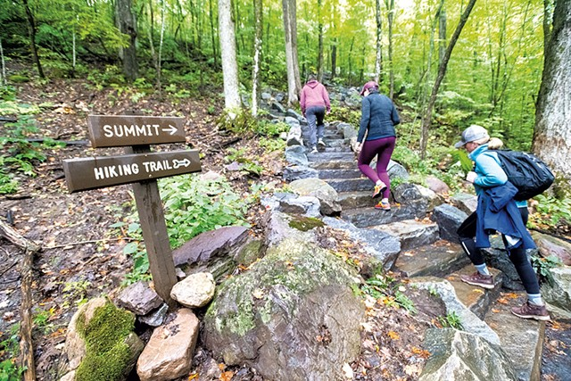 Mount Philo hikers climbing a new stone staircase - JAY ERICSON