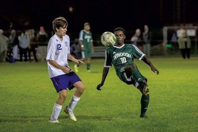 Winooski's Shabani Omar kneeing the ball during a soccer match against Oxbow High School - DARIA BISHOP