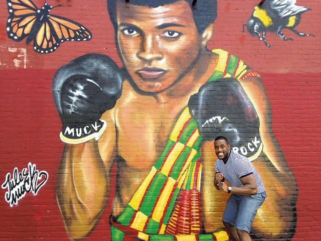 Prince Nartey Awhaitey with the mural - KEN PICARD