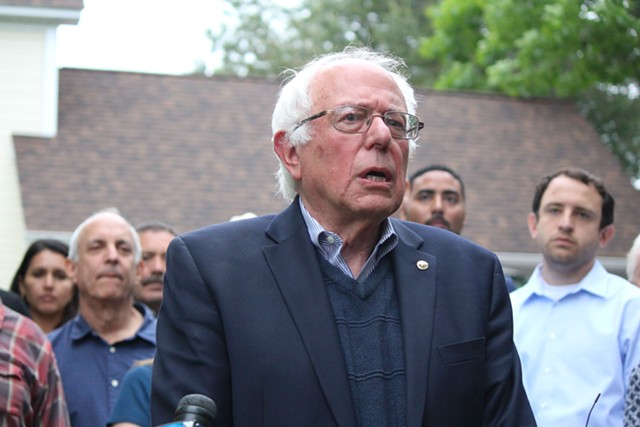 Sen. Bernie Sanders addresses reporters Sunday outside his Burlington home. - PAUL HEINTZ