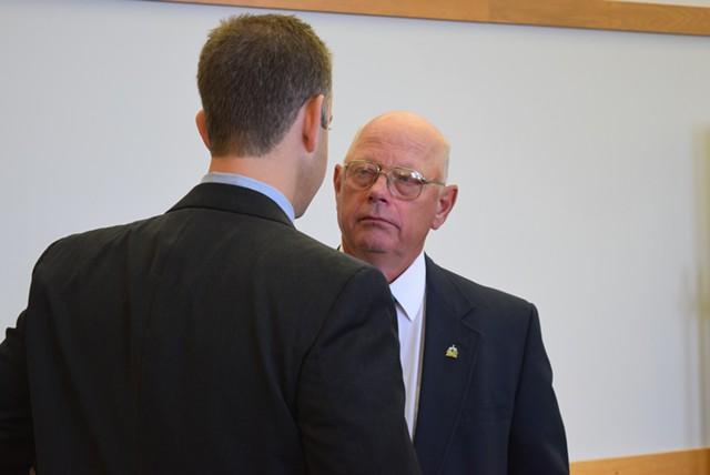 Sen. Norm McAllister, right, confers with attorney Brooks McArthur in court Monday. - TERRI HALLENBECK