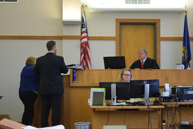 Defense attorney Brooks McArthur and Deputy State's Attorney Diane Wheeler discuss pretrial motions with Vermont Superior Court Judge Robert Mello on Monday. - TERRI HALLENBECK