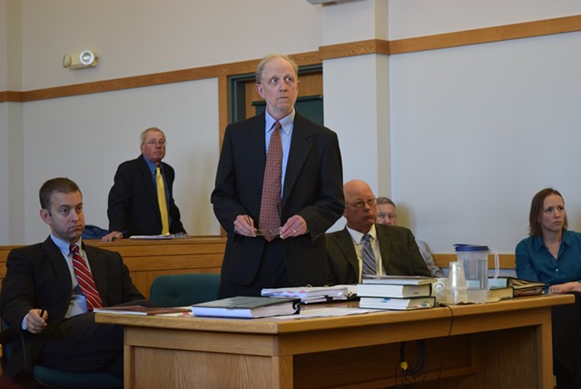 Defense attorneys David Williams (standing) and Brooks McArthur (left) argue motions Tuesday for Sen. Norm McAllister (right), a day before his sexual assault trial begins. - TERRI HALLENBECK