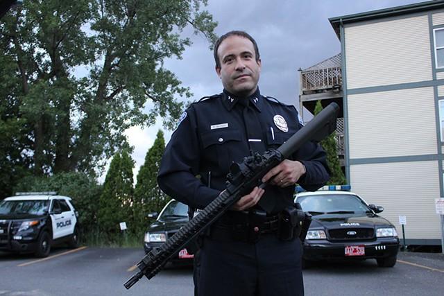 Burlington Police Chief Brandon del Pozo on Monday with the AR-15 - PAUL HEINTZ