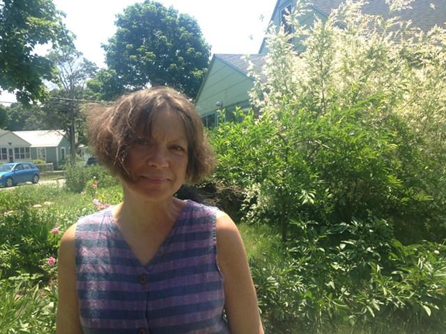 Anna Carey stands in her garden on Blodgett Street - MOLLY WALSH