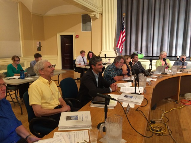 Chief administrative officer Bob Rusten, far left, sits next to Mayor Miro Weinberger at Monday's council meeting. - ALICIA FREESE