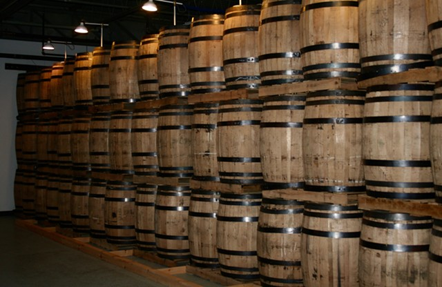 Whiskey barrels in the aging room - SUZANNE PODHAIZER